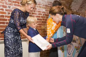Last years 'Victory Trophies' design winner Leo Howard showing HRH the Duchess of Cambridge his winning design (c) Lloyd Images